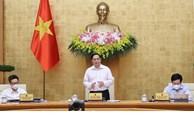 越南政府总理范明正主持政府6月例行会议