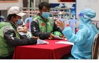 胡志明市为网约配送员提供免费新冠病毒检测