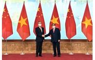 越南政府总理范明正会见中国国务委员兼外交部长王毅